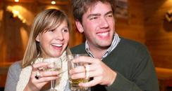 Couple drinking in a pub