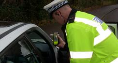 A&S Police carry out a breath test on a motorist