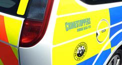Police car with Crimestoppers logo