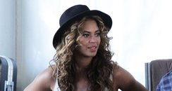 Beyonce backstage wearing summer hat and shorts