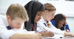 Pupils working at desks in school