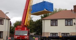 Two room extension being lowered into position