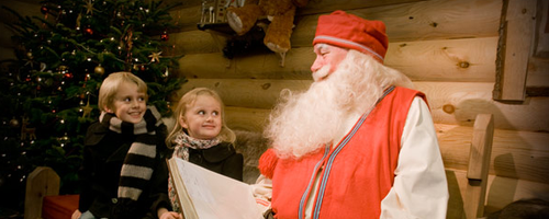 LaplandUK Santa reading to a boy and girl