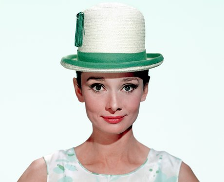 Audrey Hepburn in a green and white bowler hat