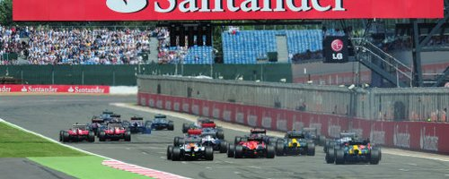 Cars move off the grid at the British Grand Prix.