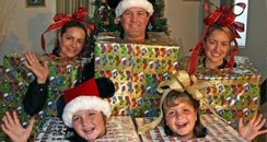 A family wrap up in christmas wrapping paper