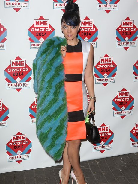 Lily Allen in an orange and black dress