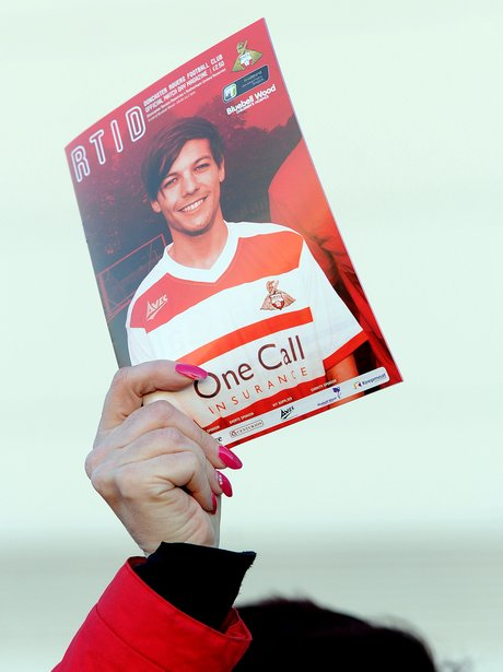 Louis Tomlinson on the cover of a matchday program