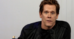 Kevin Bacon talks directly to camera