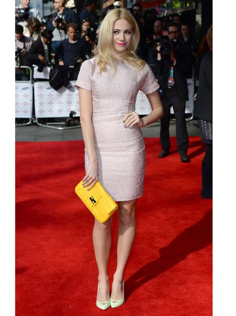Pixie Lott in a pale pink dress holding clutch