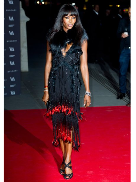 Naomi Campbell in a black tassle dress