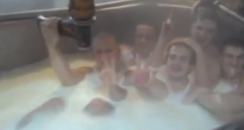 Men in a bath of milk
