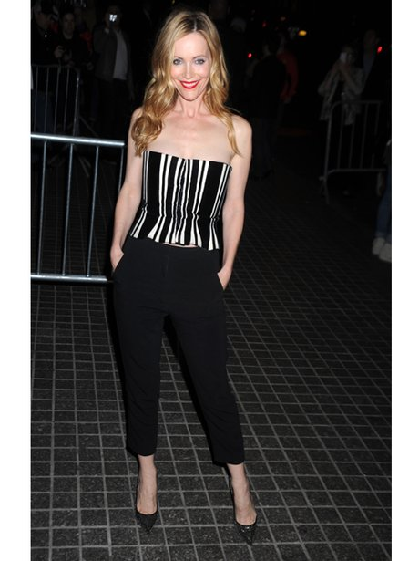 Leslie Mann in a crop top and trousers