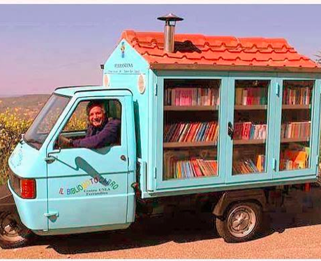 A man driving a car full of books