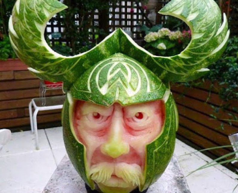A watermelon carved into a Viking's face