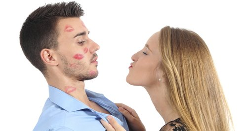 Woman trying to kiss man