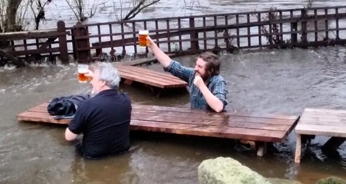 Men Drink Leeds Pub Flooded