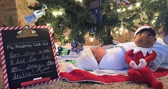baby under christmas tree facebook