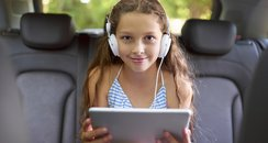 Child on tablet in the car
