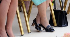 Queen Elizabeth hires someone to wear in her shoes