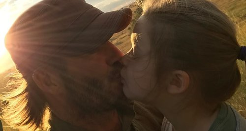 David Beckham kissing harper