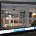 Van crashes into station doors